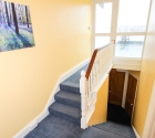 Hallway and staircase in plymouth university shared student flat.