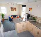 Open plan modern kitchen dining area in plymouth university shared flat.