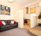 Open plan lounge and kitchen in University of Plymouth student flat.