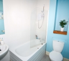 Refurbished Plymouth University property bathroom with bath.