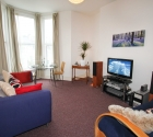 Large communal lounge with sofas in Plymouth University 1 bed student flat.