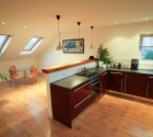 Open plan kitchen dining room in plymouth university modern shared flat.